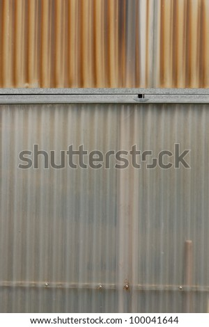 Aluminum and corrugated plastic background. Greenhouse construction detail. - stock photo