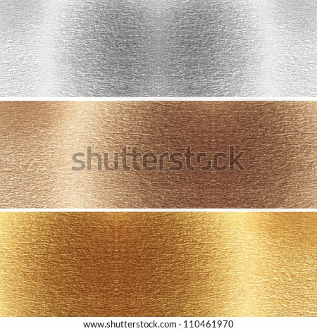 Aluminum, brass and golden plates with some reflected lights and reflections