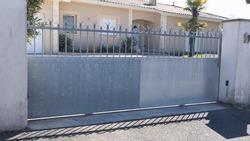 Aluminum brut steel modern design gray metal silver gate house portal of suburb home