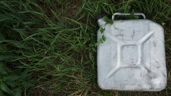 Aluminum can with gasoline in the grass. Biodiesel. Environmental protection. Ecology