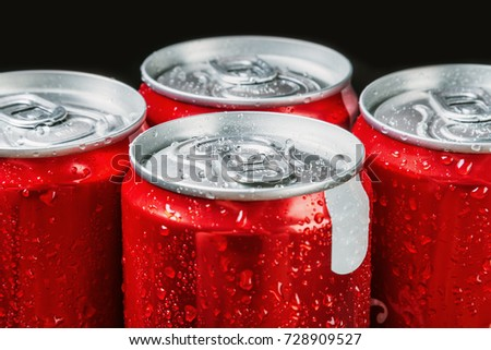 aluminum cans of soda. Soft focus. The focus in the middle of the frame #728909527
