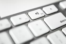 Aluminum computer keyboard, volume up button