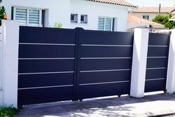Aluminum dark gray paint metal gate house portal of suburb home door