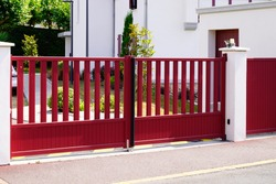 Aluminum dark red metal gate of suburb house steel door