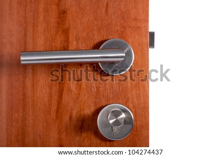 Aluminum door knob on the black door white background.