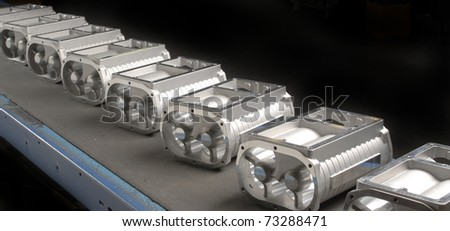 Aluminum engine parts on an assembly line