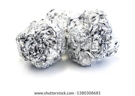 Aluminum foil ball isolated on white background #1380308681