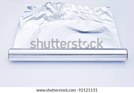 aluminum foil roll for wrapping and cooking food isolated on white