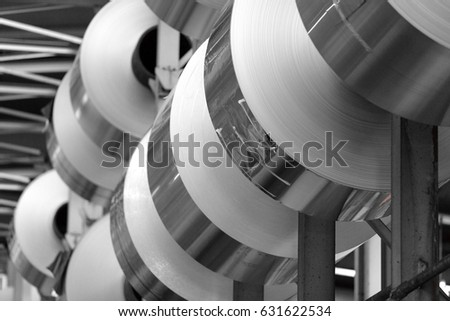 aluminum foil stacked in a warehouse for heavy coils
