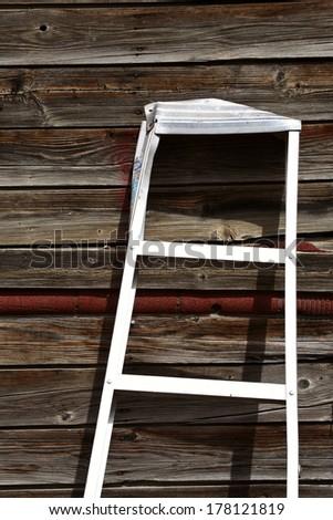 Aluminum ladder against old garage in Saskatchewan