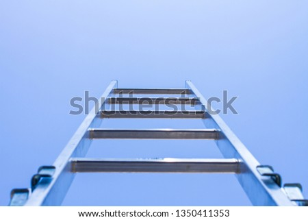 aluminum ladder and blue sky