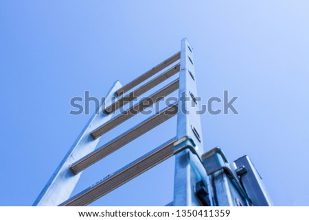 aluminum ladder and blue sky #1350411359