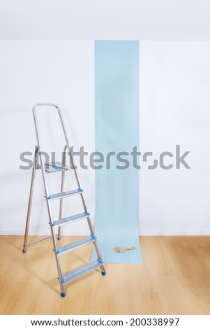 Aluminum ladder in interior room with roll paper