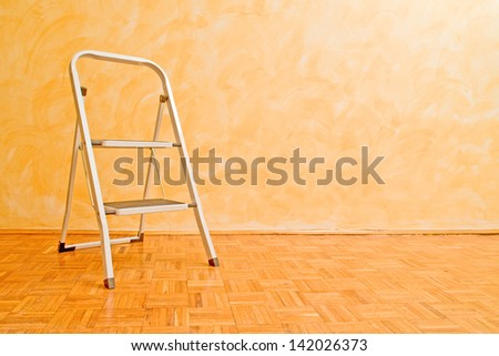 Aluminum ladder in the room, useful for housework.