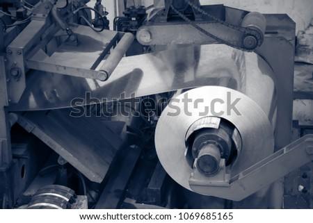 Aluminum on machine in workshop #1069685165