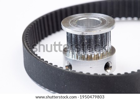 Aluminum pulley with timing belt for cnc machines above white background. Photo stock ©