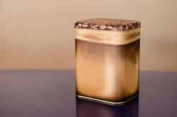 Aluminum Tin Can painted with coffee granules on brown background Canned packaging for coffee or tea, gift box.