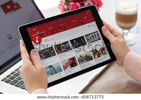 Alushta, Russia - October 20, 2016: Woman holding a iPad Pro Space Gray with video sharing website YouTube on the screen. iPad Pro 9.7 was created and developed by the Apple inc.