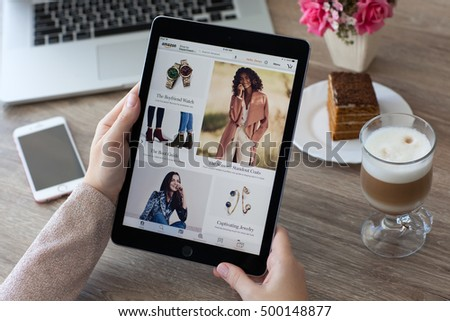 Alushta, Russia - October 9, 2016: Woman holding a iPad Pro with Internet shopping service Amazon on the screen. iPad Pro 9.7 Space Gray was created and developed by the Apple inc.