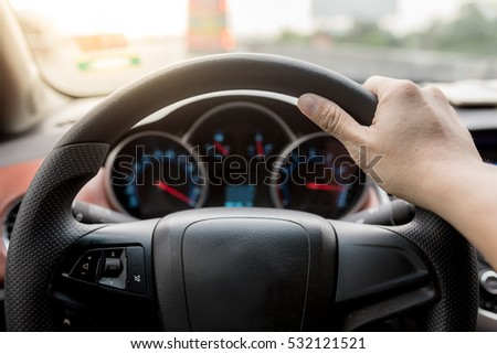 Always on the move. Close-up of hands on steering wheel drive a car