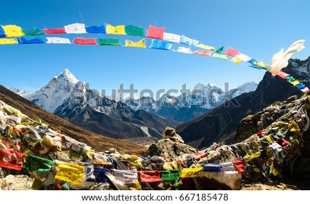 Ama Dablam framed with praying flags - Nepal
