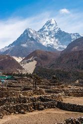 Ama Dablam mountain peak behind Pangboche village in Everest base camp trekking route. Himalaya mountains range in Nepal, Asia