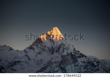 Amadablam peak at sunset in Khumbu valley in Nepal, Himalayas #578644522