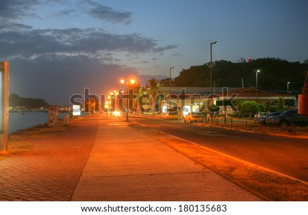 Amador Causeway in the sunset, the Pacific entrance to the Panama Canal, Panama, Central America. A one-lane road runs along the causeway to each island, and there is a bicycle/jogging path as well.