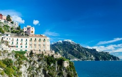 Amalfi coast, the coastal road between the port city of Salerno and clifftop Sorrento winds past grand villas, terraced vineyards and cliffside lemon groves