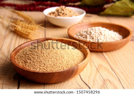 Amaranthus,Sweet barley(sticky barley),Mix millet above the wooden table.
