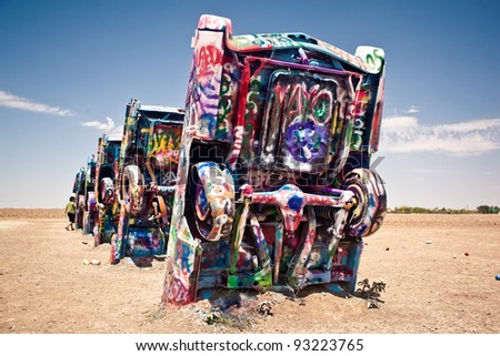 AMARILLO, TEXAS - JULY 10: Famous art installation Cadillac Ranch on July 10,2011 near Amarillo, Texas. It was created in 1974 by C. Lord, H. Marquez and D. Michels and consist from 7 buried Cadillacs