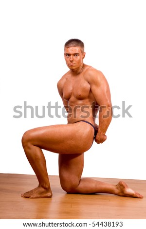 stock photo : amateur bodybuilder posing in gym