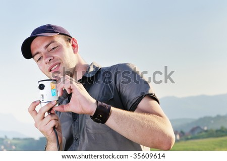 amateur photographer with point and shoot photo camere outdoor in nature