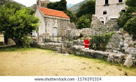 Amateur traveler visits ancient ruins on vacation #1176191314