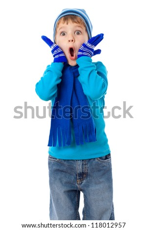 Amazed little boy in winter clothes, isolated on white