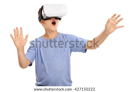 Amazed little boy looking in a VR goggles and gesturing with his hands isolated on white background