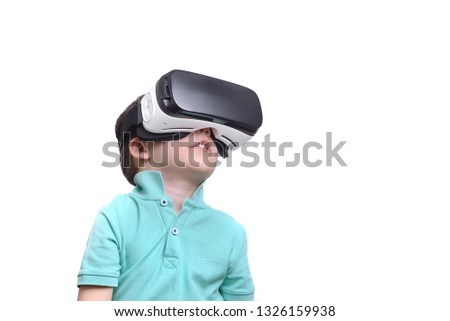 55067269149e Amazed teen boy wearing virtual reality goggles watching movies or playing  video games