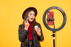 amazed teen girl blogger use selfie led lamp and smartphone, selfie.