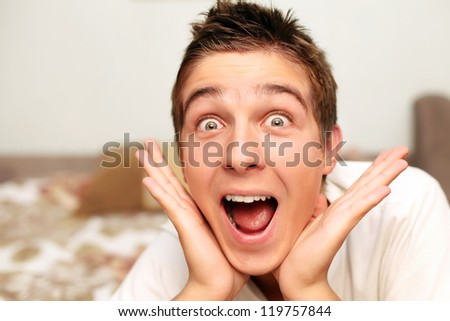Amazed Teenager on the bed in Home interior
