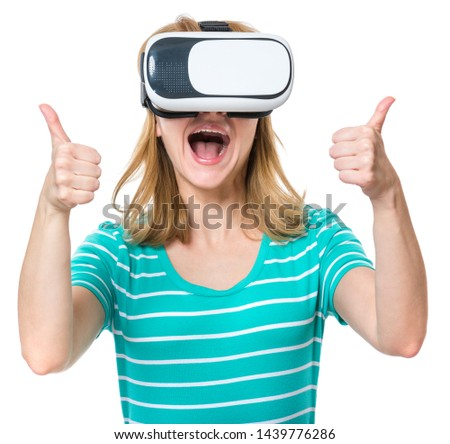 Amazed woman wearing virtual reality goggles watching movies or playing video games, isolated on white background. Surprised girl looking in VR glasses. People experiencing 3D gadget technology.