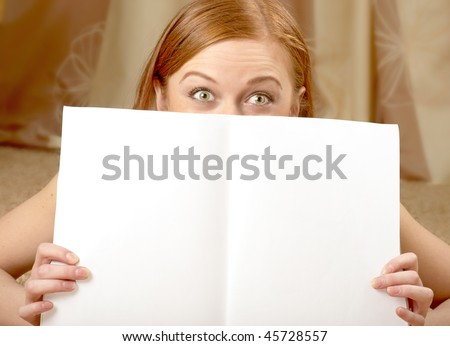 Amazed Woman with white pages of a magazine