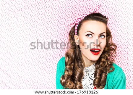 Amazement - beauty woman excited looking to the side. Surprised happy young woman looking sideways in excitement. copy space