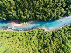 Amazing aerial shot of beautiful blue Tara river. Forest background.