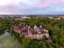 Amazing aerial view about the Vajdahunyad castle in the city park of Budapest Hungary. This gothic stlye historical builing it has next to Szechenyi thremal bath. Famous popular tourist attraction