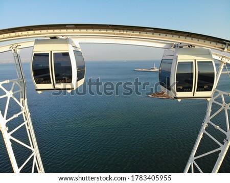 Amazing aerial view from above by drone on capital of Azerbaijan - Baku. Giant Ferris wheel on seaside of Caspian Sea