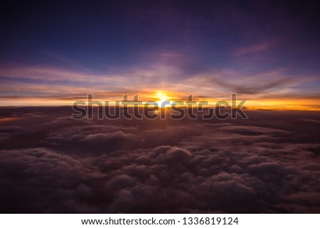 Amazing and beautiful sunset above the clouds with dramatic clouds #1336819124