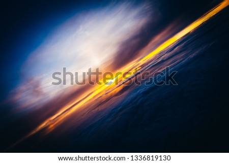 Amazing and beautiful sunset above the clouds with dramatic clouds #1336819130