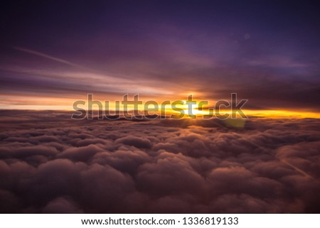 Amazing and beautiful sunset above the clouds with dramatic clouds #1336819133