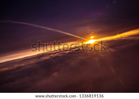 Amazing and beautiful sunset above the clouds with dramatic clouds #1336819136