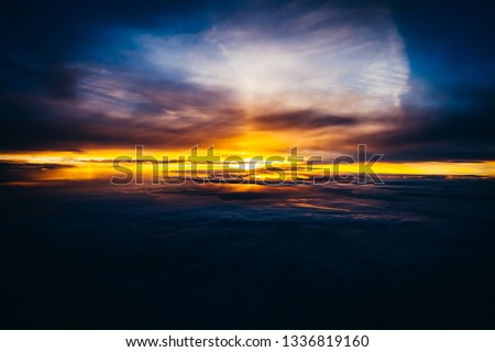 Amazing and beautiful sunset above the clouds with dramatic clouds #1336819160